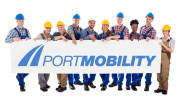 Portrait of happy construction workers holding blank billboard against white background